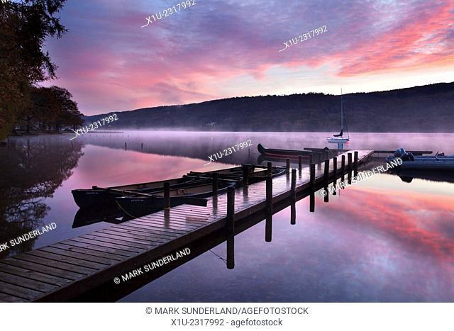 Jetty and Boats at Dawn Coniston Water near Coniston Lake District Cumbria England