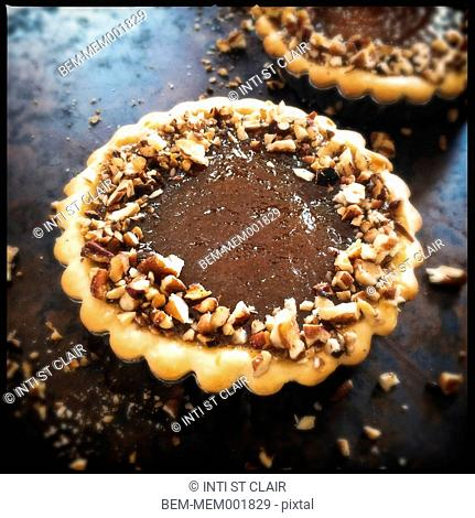 Close up of delicious chocolate pie with nuts