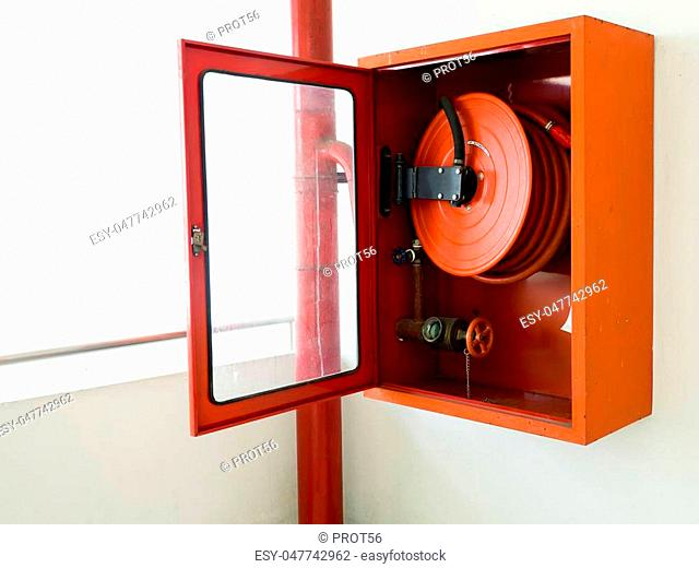 Fire extinguisher with various types of fire extinguishers Located In the white wall. copy space for text and content