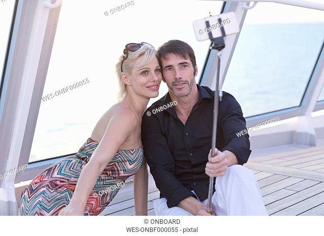 Couple taking selfies on a cruise