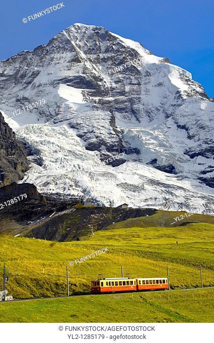 Junfraujoch fenicular railway in front of the Monch from Kleine Scheidegg - Grindelwald Switzerland