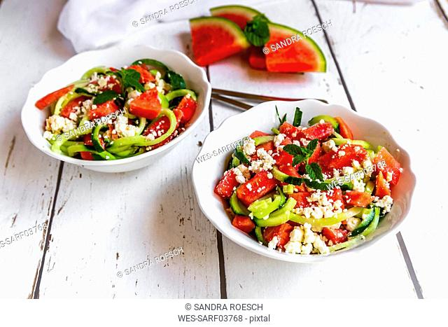 Two bowls of salad with watermelon, cucumber, feta and mint