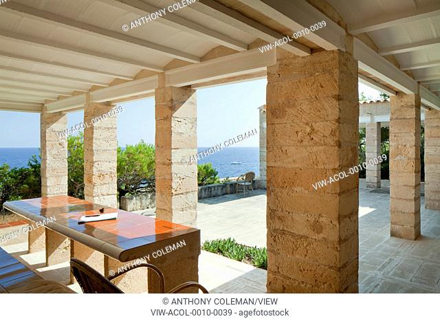 Can Lis, Mallorca, Spain. Architect: Utzon, Jorn, 1971. Main terrace and view to sea. Built in stone tiled table