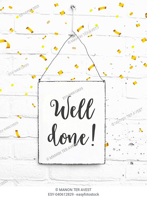 Text well done congratulations on white metal plate with confetti
