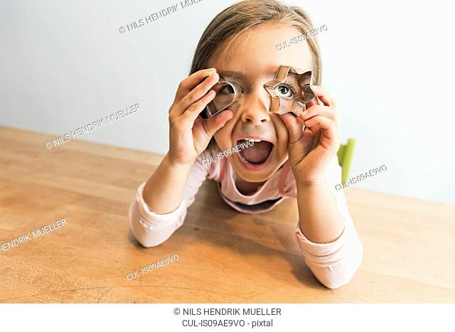 Girl playing with baking mold