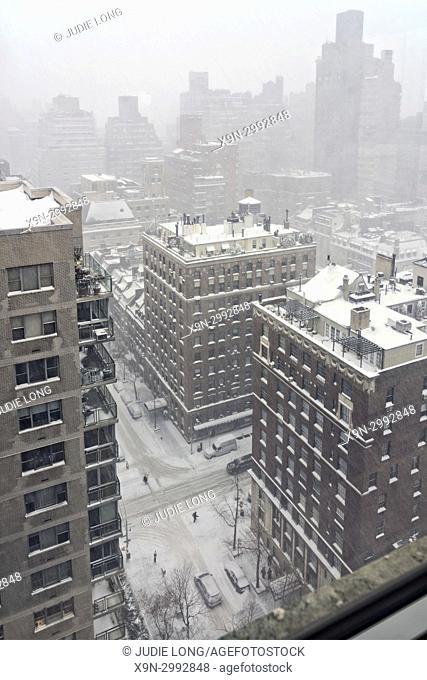 New York City, Manhattan. Blizzard Snow Storm Seen from Above East 69th Street and Lexington Avenue , Through a High Floor Apartment Window