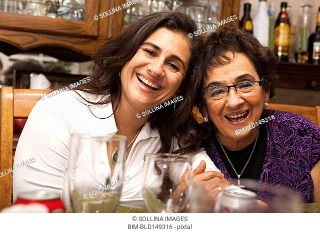 Hispanic mother and daughter at Thanksgiving dinner