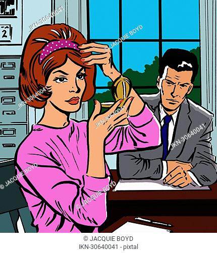 Woman fixing her hair in office