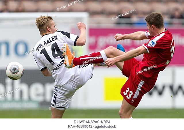 Aalen's Joel Pohjanpalo (L) vies for the ball with Kaiserslautern's Dominique Heintz during the second league match between FCKaiserslautern and VfR Aalen at...