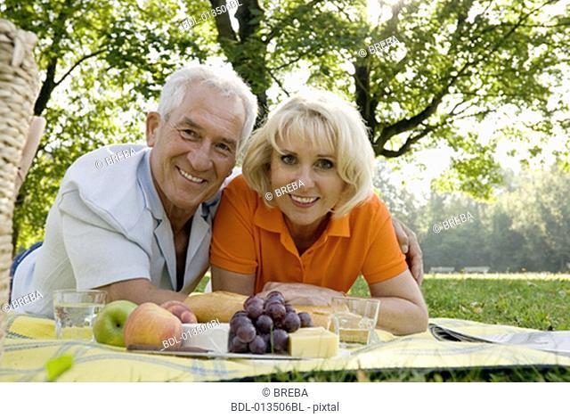 portrait of smiling mature couple at picnic