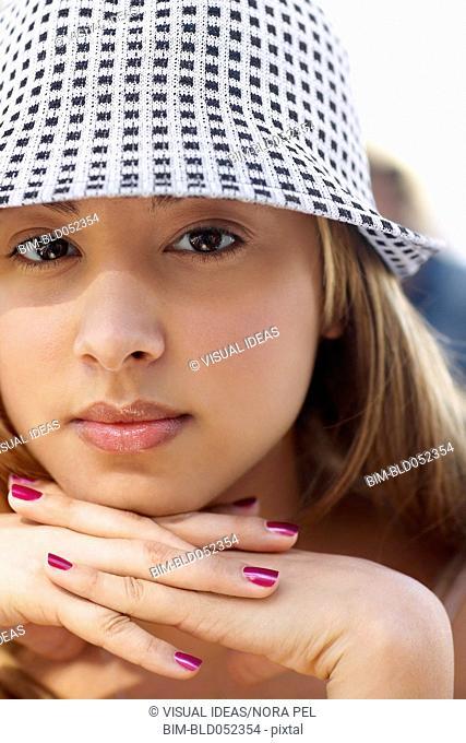 Hispanic woman wearing hat
