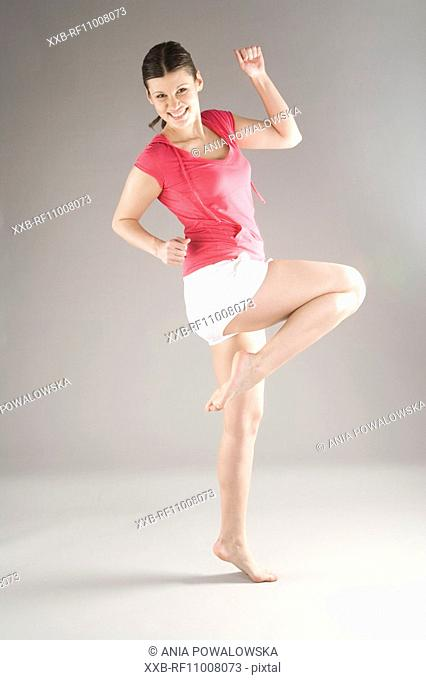 Young woman doing gym
