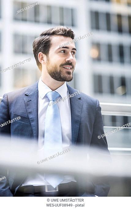 USA, New York City, smiling businessman looking around