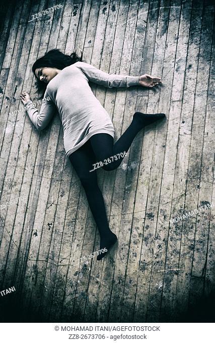 Dead woman's body on the floor