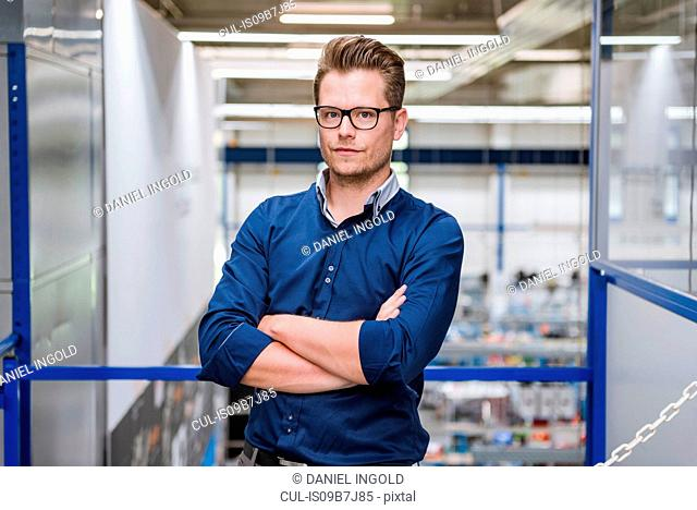 Portrait of male factory manager with arms folded in factory