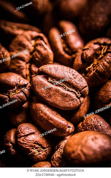 Closeup still life food macro photo on roasted dark brown coffee beans