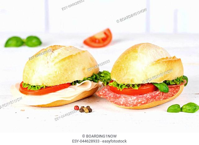 Sandwiches baguettes with salami and ham copyspace on wooden board wood