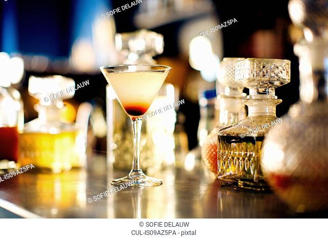Cocktail on vintage cocktail bar counter, Florence, Italy