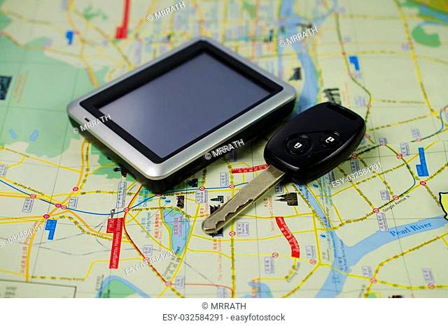 Key car and GPS on MAP for travel background stock photo