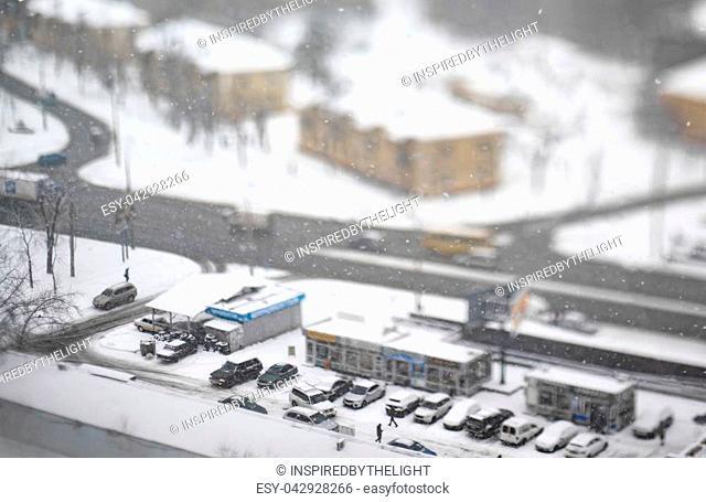 November snowfall. Aerial view. Tilt-shift cityscape
