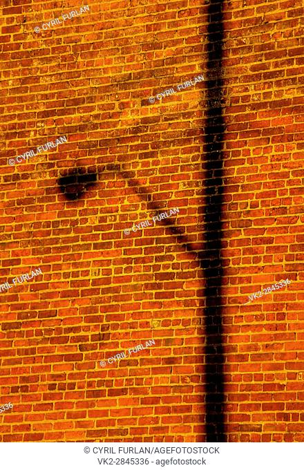 Shadow of a street light on a brick wall in Brooklyn New York