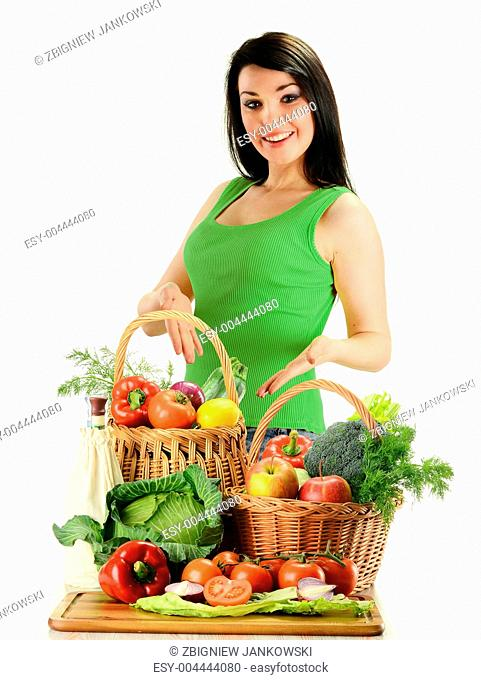 Young woman and wicker basket with vegetables isolated on white