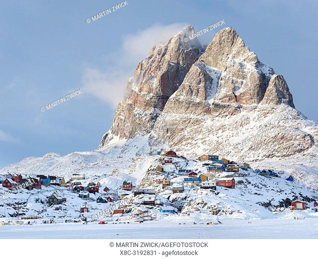 Town Uummannaq during winter in northern Greenland, seen from the frozen fjord. America, North America, Denmark, Greenland