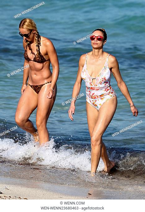 German tennis pro Sabine Lisicki wears a tiny leopard print bikini as she hangs out with Lilly Becker on the beach in Miami on Easter Weekend Featuring: Lilly...