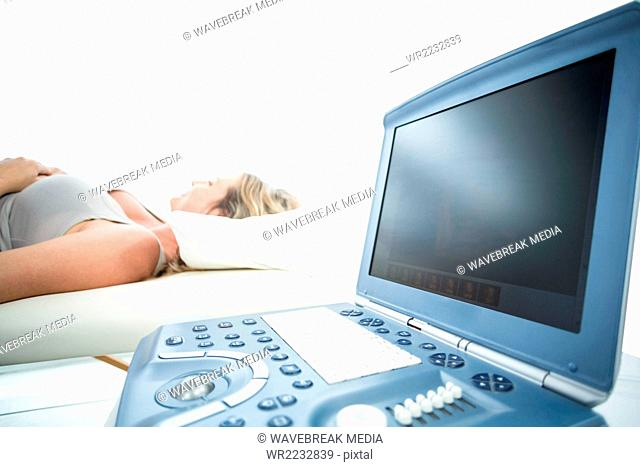 Pregnant woman receiving ultrasound treatment