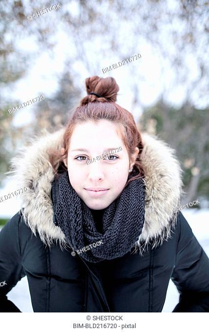 Caucasian teenage girl wearing parka outdoors