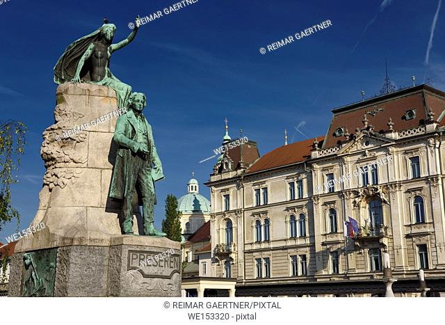 Bronze sculpture of national poet Preseren Monument with Muse and historic Kresija building with municipal offices and dome of Ljubljana Cathedral