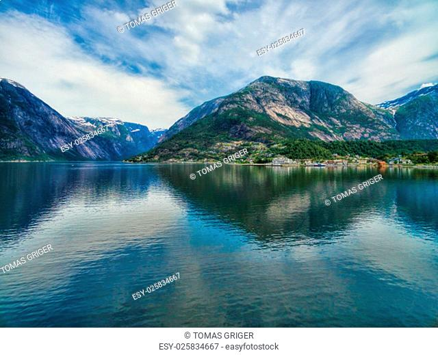 Scenic aerial view of norwegian fjord surrounded by high mountains