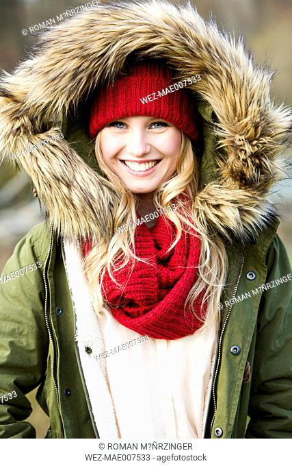 Portrait of young woman wearing woolly hat and hooded jacket
