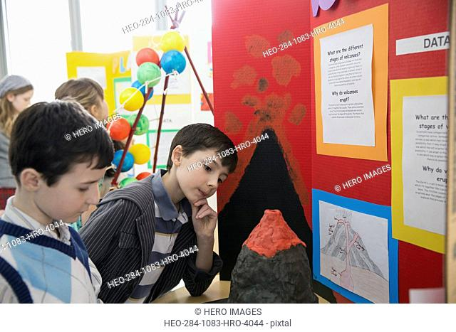 Elementary boys with volcano project at science fair