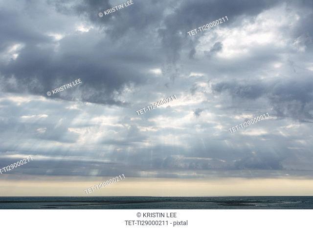 Scenic cloudscape with sunbeams