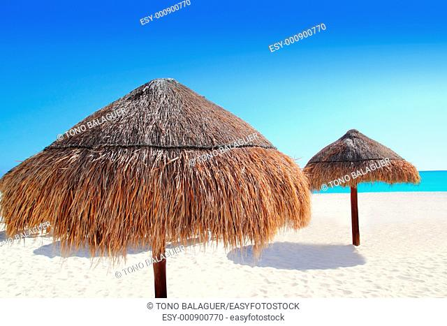 beach traditional sunroof hut caribbean umbrellas dried grass and wood