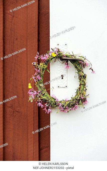 Flower wreath on door handle