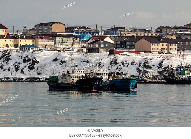 boat at the pier in the port of the Russian city of Yuzhno-Sakhalinsk on the island of Kunashi