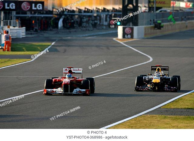 Race, Fernando Alonso ESP, Scuderia Ferrari, F-150 Italia and Sebastian Vettel GER, Red Bull Racing, RB7, F1, Japanese Grand Prix, Suzuka, Japan