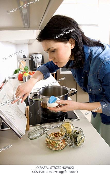 Woman using kitchen timer