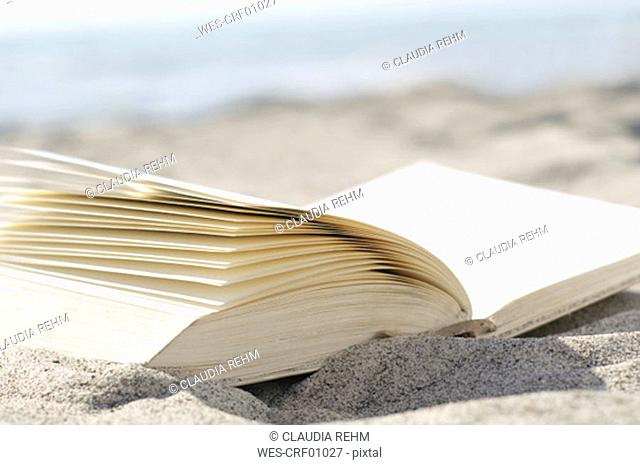Book on beach, close-up