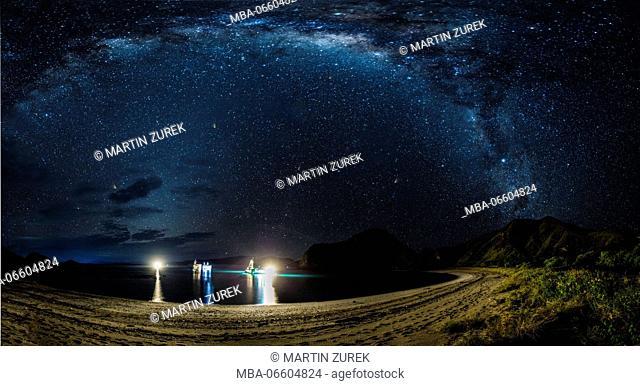 Milkyway at new moon over Gili Padar, panorama, beach, light, boats, ships, illumination