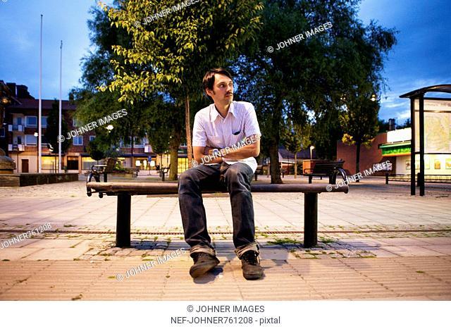 Man sitting on a bench, Sweden
