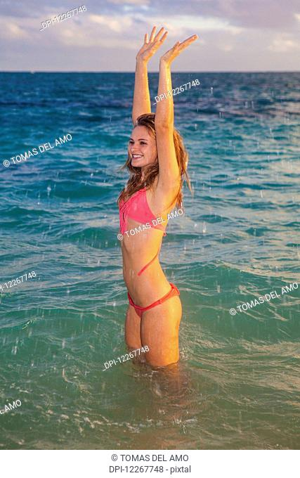 Teenage girl at the beach; Kailua, Island of Hawaii, Hawaii, United States of America