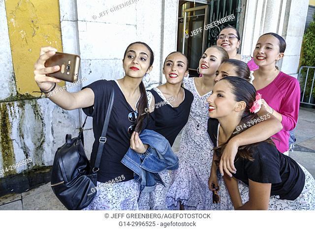 Portugal, Lisbon, Baixa, Chiado, historic center, Praca do Comercio, Commerce Square, public plaza, Festas de Lisboa, festival, performers, dance group, girl