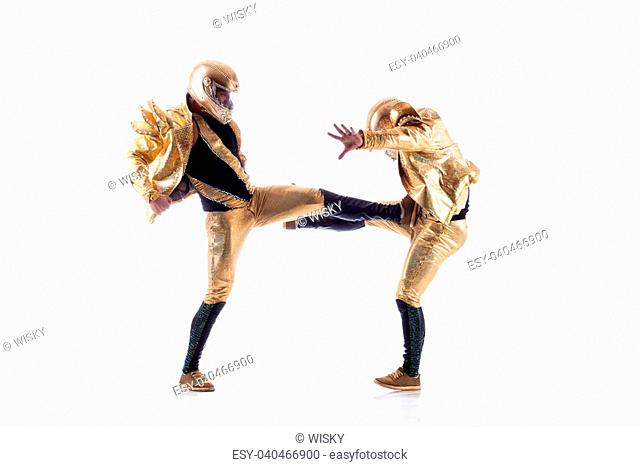 Sexy go-go performers fighting in studio, isolated on white