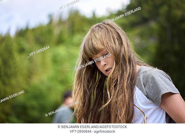 thoughtful young girl enjoying nature