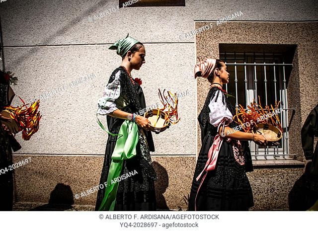 Girls dressed in traditional costume of Llanes, Asturias. during a procession