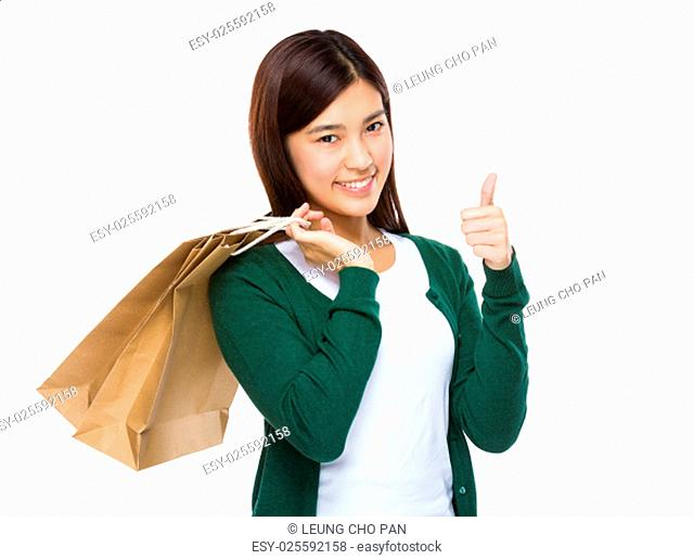 Woman with shopping bag and thumb up