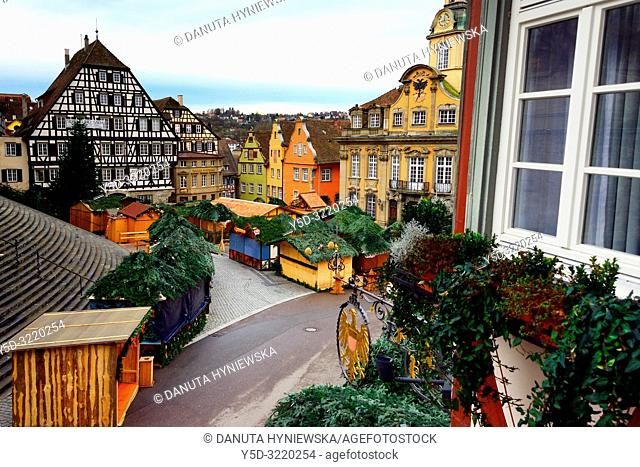Christmas market at Marktplatz seen from the window, on left stairs leading to St Michael's Church, on right - town hall, historic part of Schwäbisch Hall